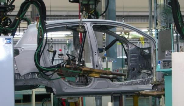 An automobile is being manufactured