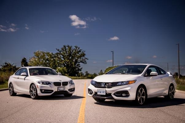 BMW 228i and Honda Civic Si angular side on road