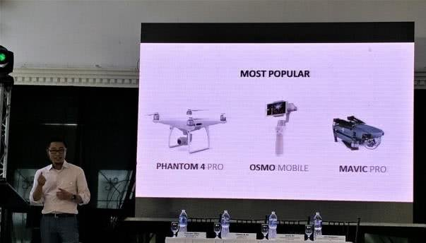 A man is giving speech on DJI devices at a seminar