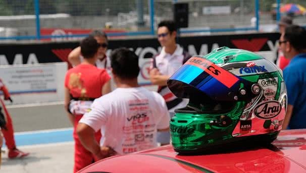 a helmet on a racing car