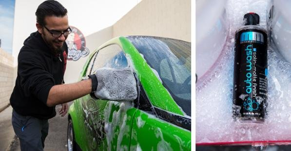 a man washing a green car