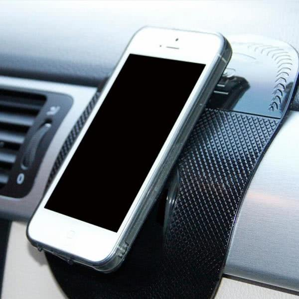 an iphone on an anti-slip car pad