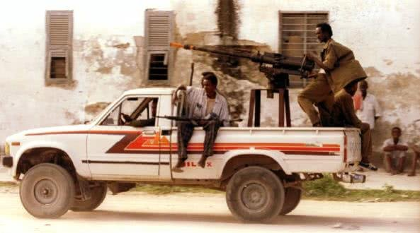 Some IS fighters using a weapon on a Toyota pickup truck
