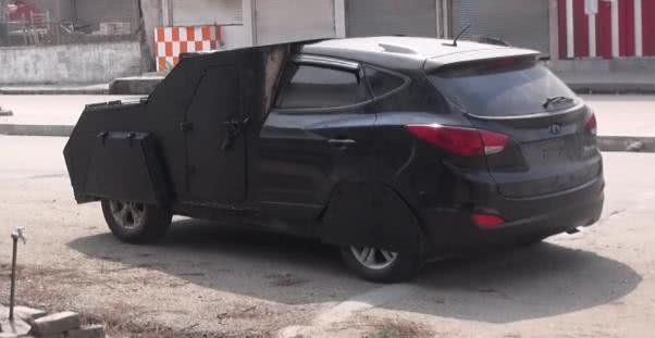 a black Kia SUV with the front modified by ISIS