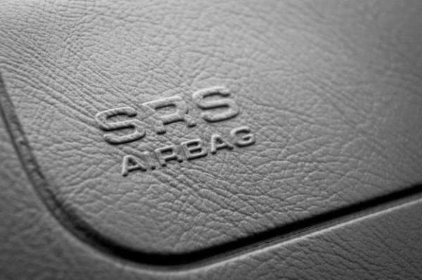 SRS airbag lettering on leather surface