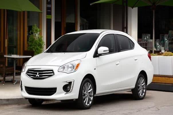 Angular front view of a white Mitsubishi Mirage G4