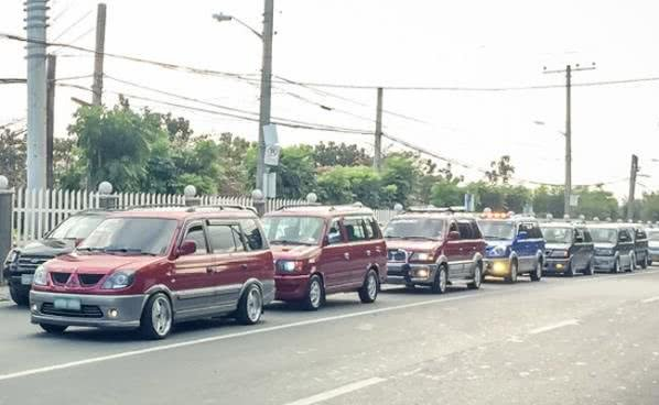 a line of Mitsubishi Adventure on street