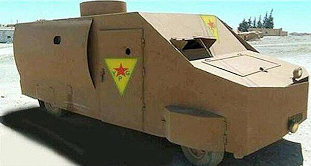Yellow homemade tank by the Kurds angular front view