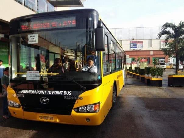 Yellow premium point to poin bus front view
