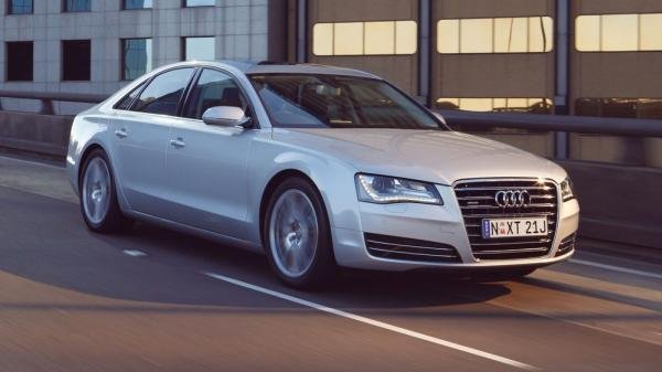 Angular front view of a Silver Audi A8 on road