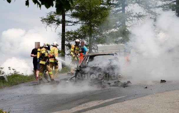 Firefighters are putting out the fire in the Audi A7