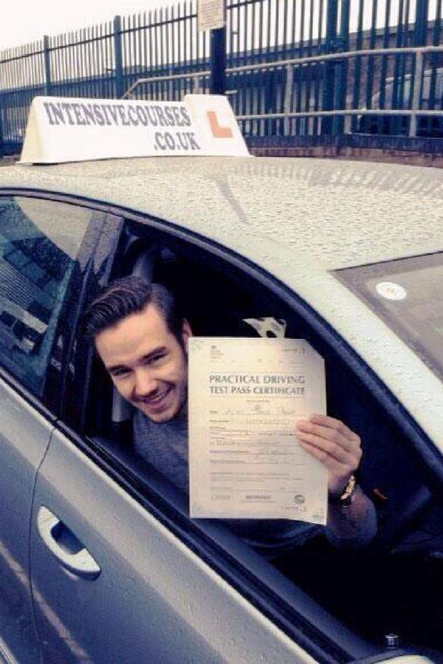 Liam Payne sitting in a car and holding a sheet of paper