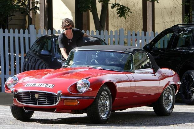 Harry Styles and his red Jaguar E-Type Roadster