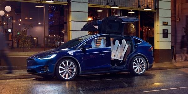 Side view of the blue Tesla Model X SUV