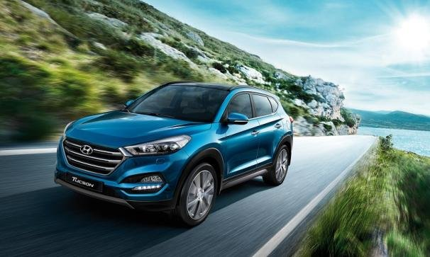 A blue Hyundai Tucson on the road