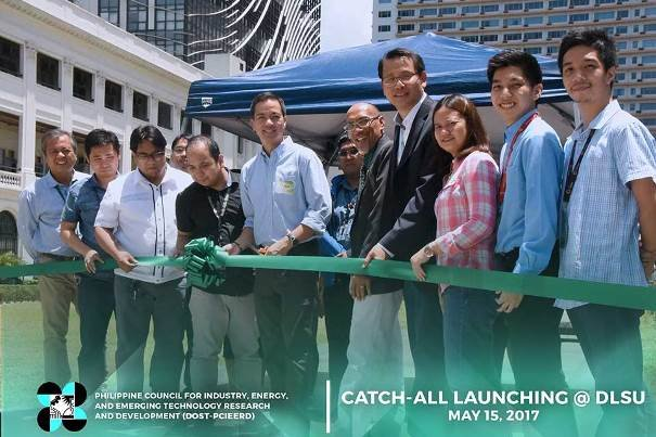 People cutting a green ribbon at the launching ceremony of CATCH-ALL