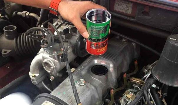 a can of Pertua Oil & Metal Treatment above engine hood