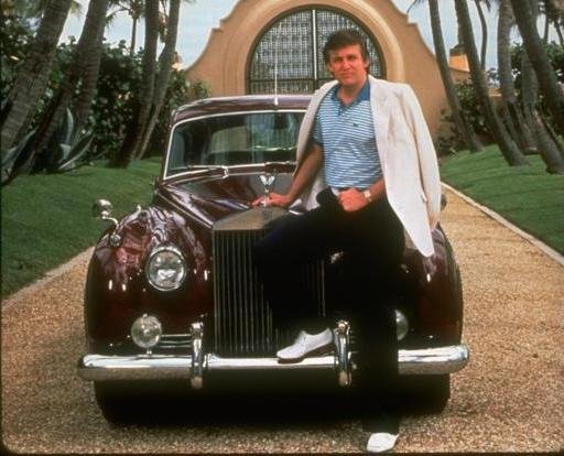 Trump sitting on the hood of his 1956 Rolls-Royce Silver Cloud