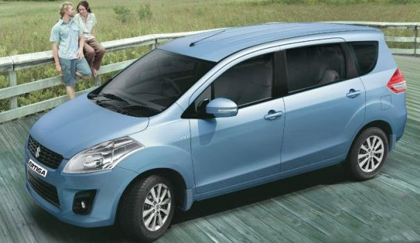 a couple and a Suzuki Ertiga