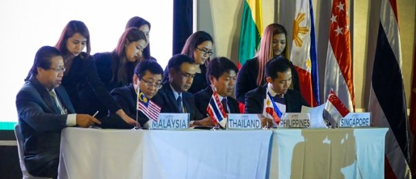 agreements being reviewed by a group of people from Malaysia, Thailand, the Philippines and Singapore