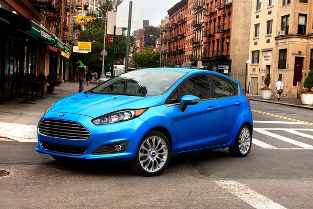A blue Ford Fiesta on the road