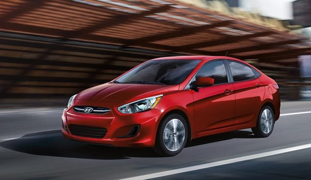 A red Hyundai Accent angular front view