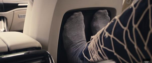 passenger putting feet on the foot massaging system in the 2018 Audi A8
