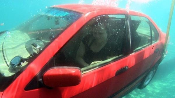 a woman stuck in a sinking car