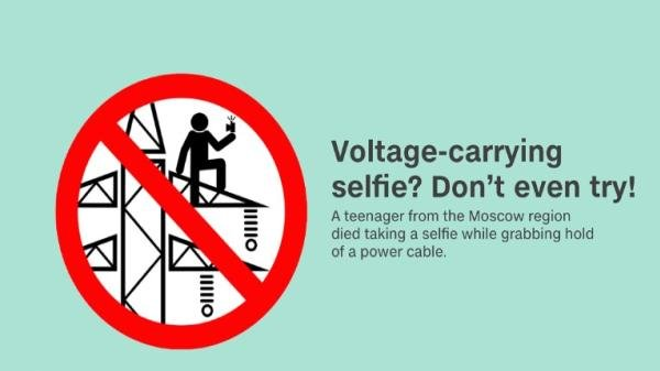 A sign warning not taking selfie on voltage