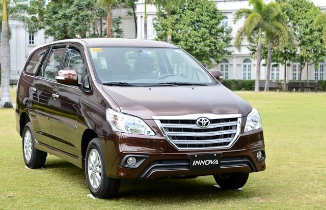 A brown Toyota Innova angular front view