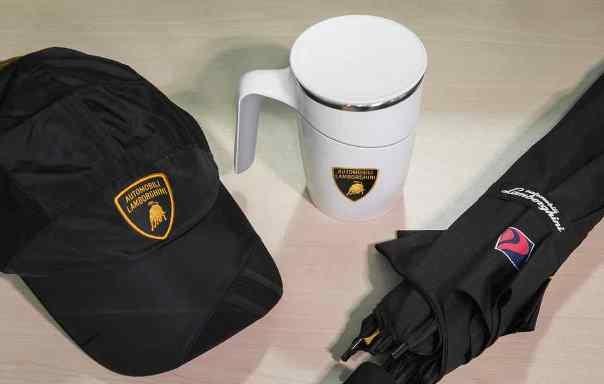A Lamborghini umbrella, a Lamborghini anti-spill mug, and a Lamborghini cap