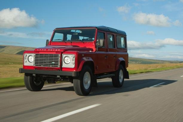 a Land Rover Defender on the road