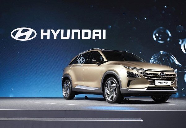 A golden fuel cell SUV angular front view