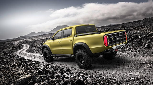 A yellow Mercedes-Benz X-Class on the road