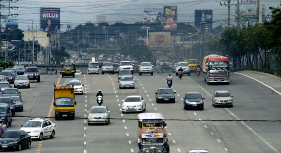 Cars plying on a Philippine highway