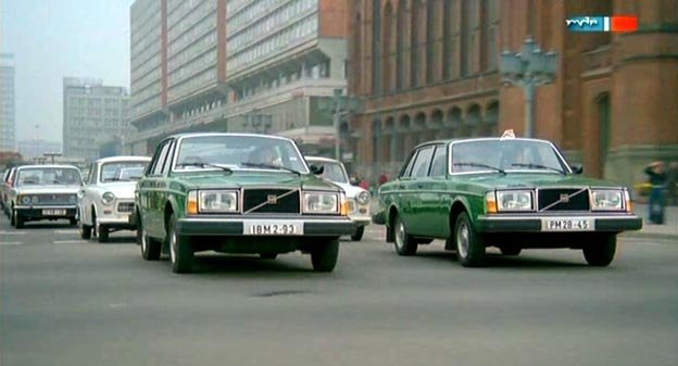 Two Volvo 144s sedan on the road