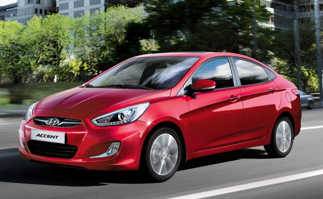A red Hyundai Accent sedan angular front view