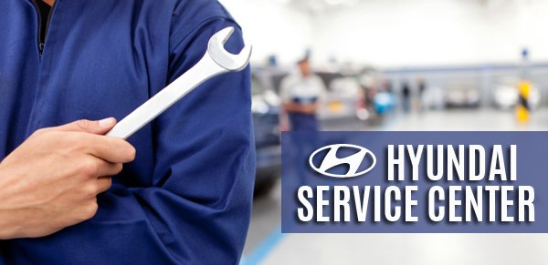 A Hyundai technician holding a wrench