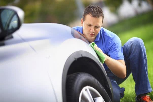 A man is cleaning his car