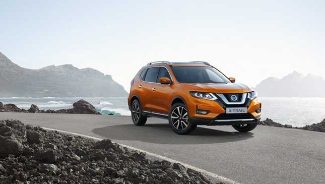 An orange Nissan X-Trail 2018 on the road