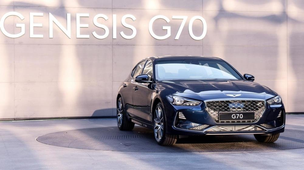 A blue Genesis G70 on display