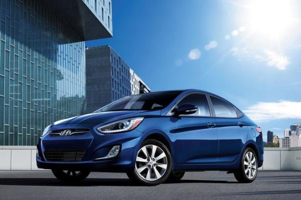 Angular front of a blue Hyundai Accent Sedan