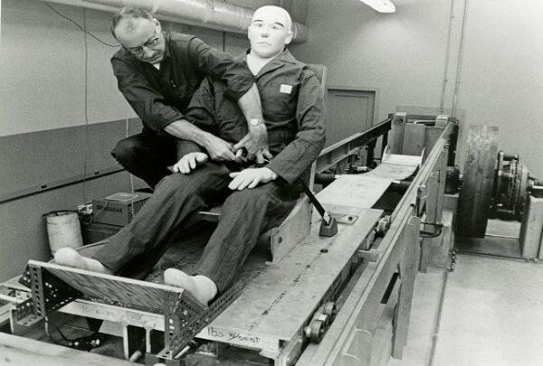 Dr. C Hunter Shelden checking retractable seat belts in 1955