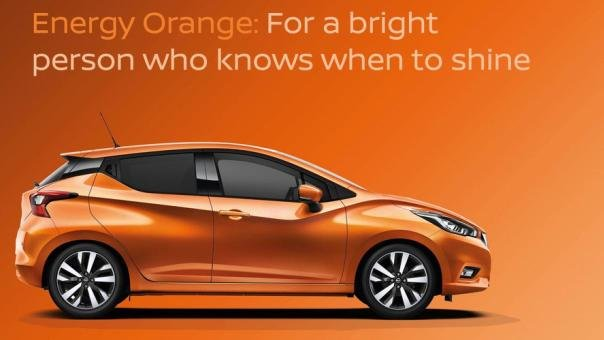 side view of the new Nissan Micra in energy orange color