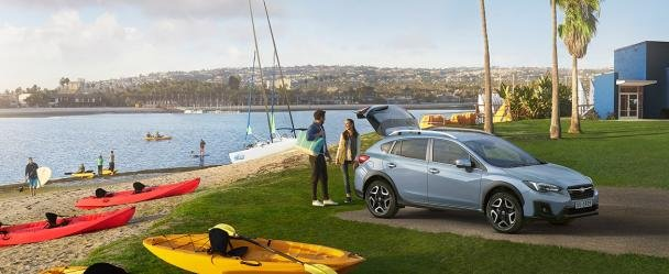 A couple and a Subaru XV 2018 outdoor
