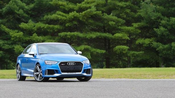 Angular front of a blue Audi RS3
