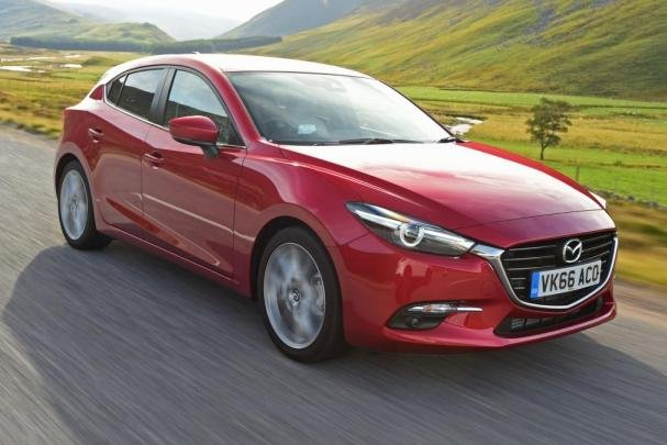Angular front of a red Mazda 3 2017