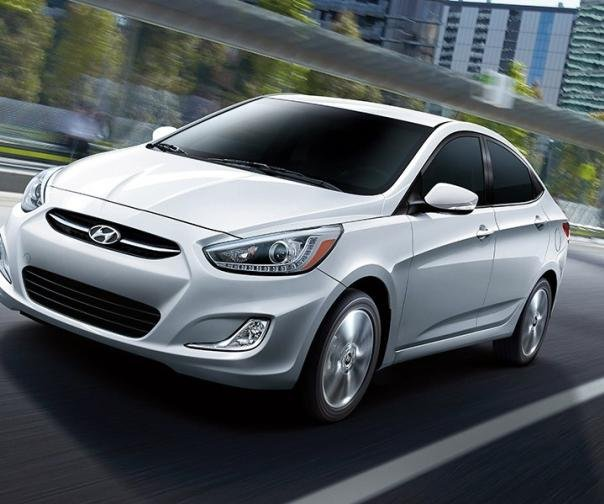 A white Hyundai Accent on the road