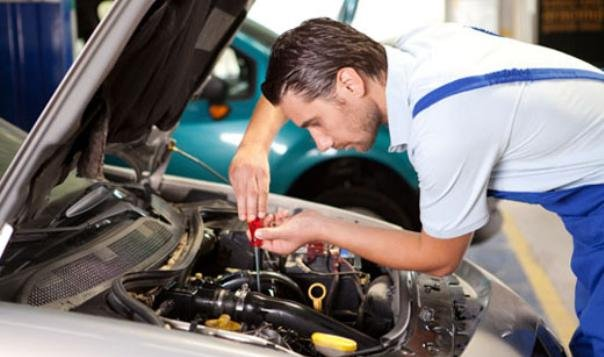 A man repairing car engine