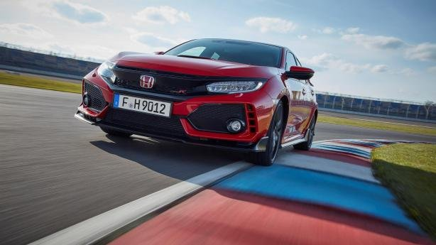 A red Honda Civic Type R on the road